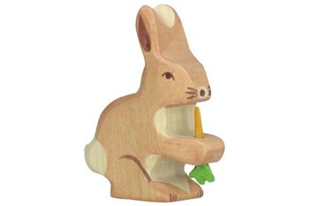 wooden toy of hare holding a carrot